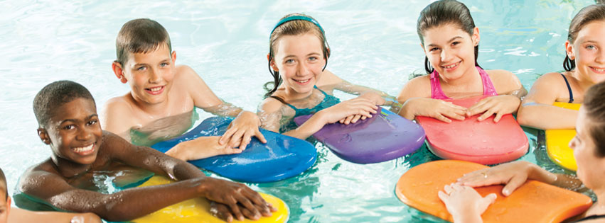 kids in pool with colorful floatation devices taking one of the best swim classes for children.